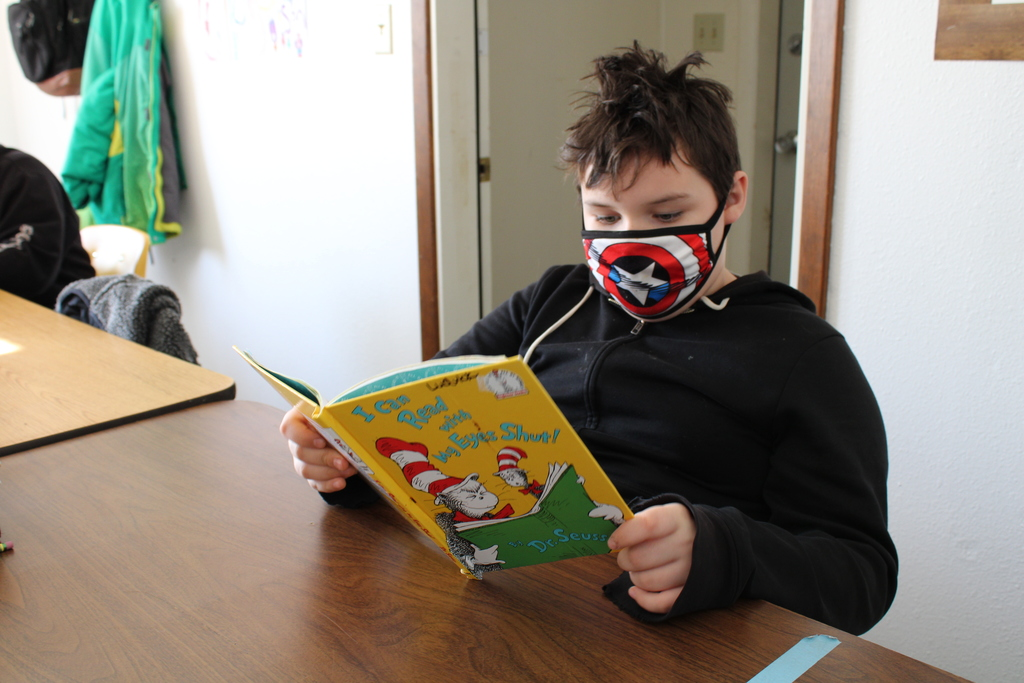 A student practicing his reading skills