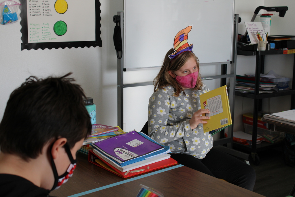 A student reading aloud to the class